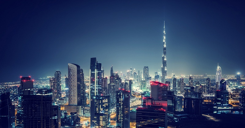 Beautiful Dubai cityscape, bird's eye view on a night urban scen